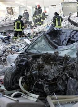 1057797229-firefighters-search-through-the-rubble-of-collapsed-buildings-in-l.jpg