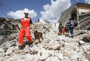1165651711-rescuers-with-sniffer-dog-search-for-survivors-amongst-the-rubble.jpg