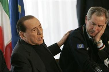 3324802773-italian-premier-silvio-berlusconi-left-and-civil-protection-chief-guido.jpg