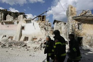 961986230-firefighters-walk-past-collapsed-buildings-in-the-village-of-castelnuovo.jpg