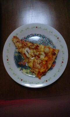 シーフードピザ一かけら